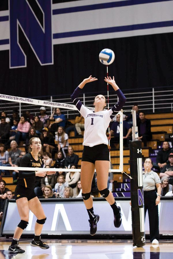 Taylor Tashima sets the ball. The junior setter and the Wildcats will try to build on some rare momentum this weekend as they travel to Iowa and Nebraska.