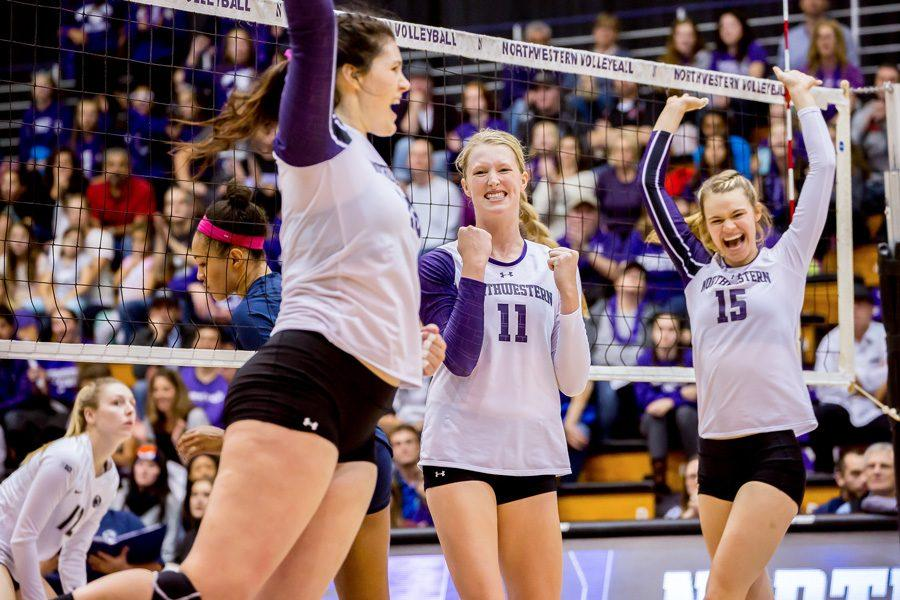 Maddie+Slater+%28center%29+celebrates+a+point.+The+senior+middle+blocker+and+her+teammates+are+seeking+their+first+Big+Ten+victory+Wednesday+against+Illinois.
