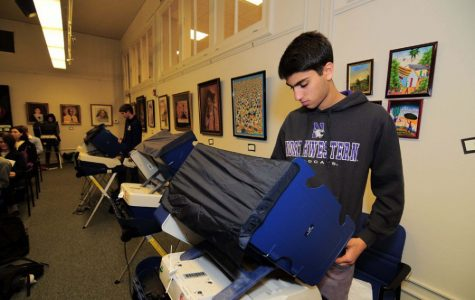 A Northwestern student casts his ballot at the Civic Center in 2014. A ruling by a federal court was stayed on Tuesday, meaning voters in larger counties will likely be able to register and vote on Election Day at their precinct.