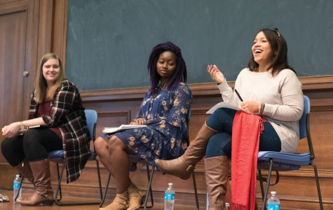 Adhana Reid (center) and theater prof. Melissa Foster (right) speak during a panel on diversity and inclusion in the Waa-Mu show at Harris Hall last month. The panelists said theater productions on campus should cast actors of color in non-stereotypical roles and represent the American population more accurately.