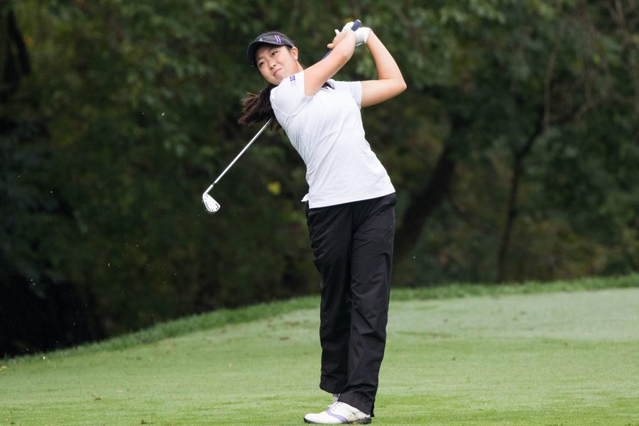 Kacie Komoto watches her ball flight. The senior struggled, along with the rest of the Cats, at the Windy City Collegiate Classic.