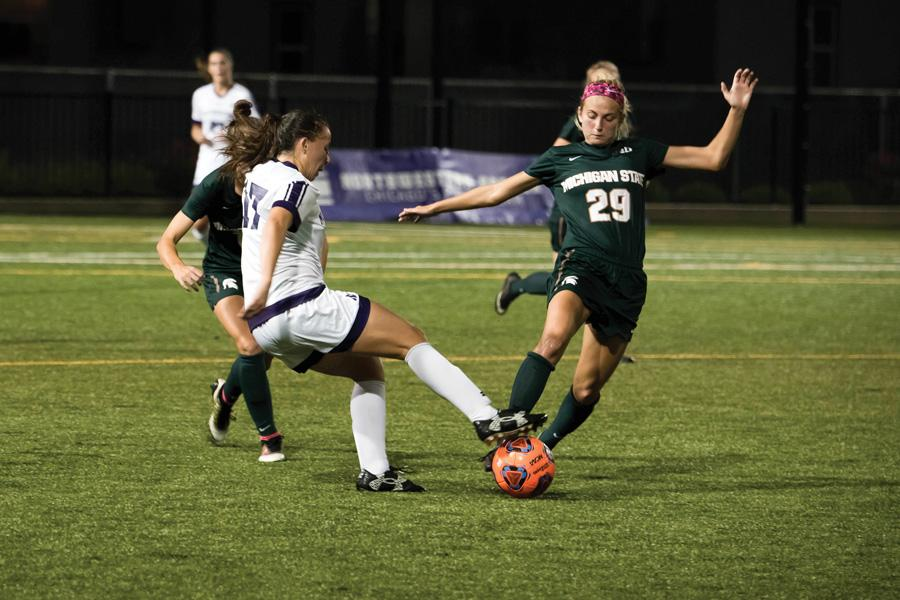 Kim Jerantowski tries to avoid defenders. The junior midfielder had two shots off the bench for Northwestern, which topped No. 19 Michigan in an emotional battle in Evanston on Sunday.