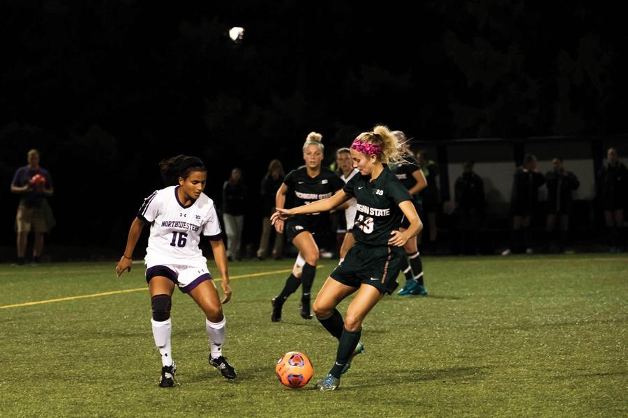 Nandi Mehta tracks an opposing player defensively. The graduate midfielder helped Northwestern to its 11th shutout of the season against Iowa.