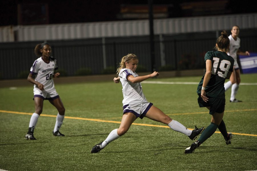 Kassidy Gorman battles for the ball. The junior defender has played further forward and been an important part of Northwestern's attack this season.
