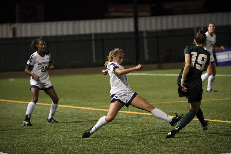 Kassidy Gorman lunges into a tackle. The junior midfielder scored the game-winning goal Thursday against Michigan State.