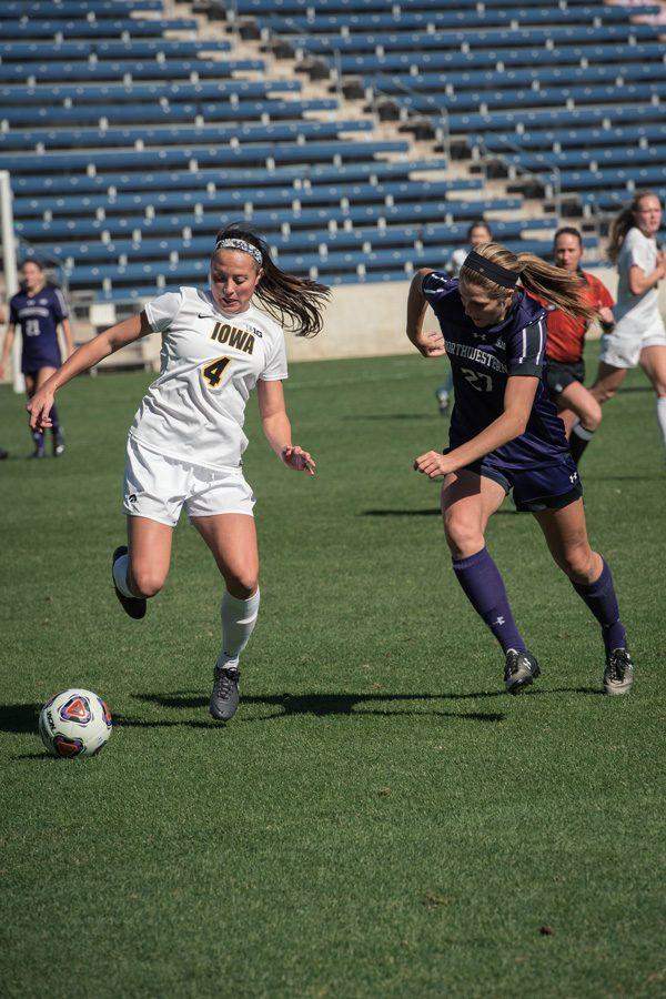 Kayla Sharples battles for the ball. The sophomore defender and the No. 24 Wildcats' defense managed their ninth shutout of the season against Ohio State.