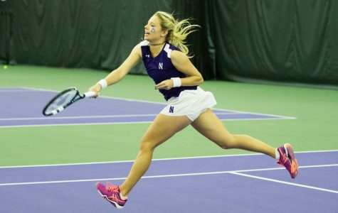 Alex Chatt reaches after the ball. The junior won one singles match at the ITA Midwest Regional but lost her second.
