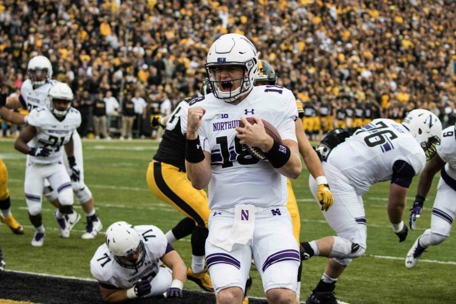 Clayton Thorson celebrates a score. The sophomore quarterback  and Northwestern will play in the Pinstripe Bowl on Dec. 28.