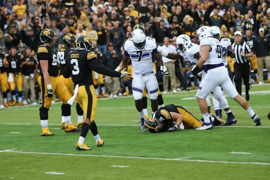 Ifeadi Odenigbo stands over Iowa quarterback C.J. Beathard after a sack. The senior defensive end and the rest of Northwestern's defensive gave up just 3.5 yards-per-carry on the ground in Saturday's win over Iowa.