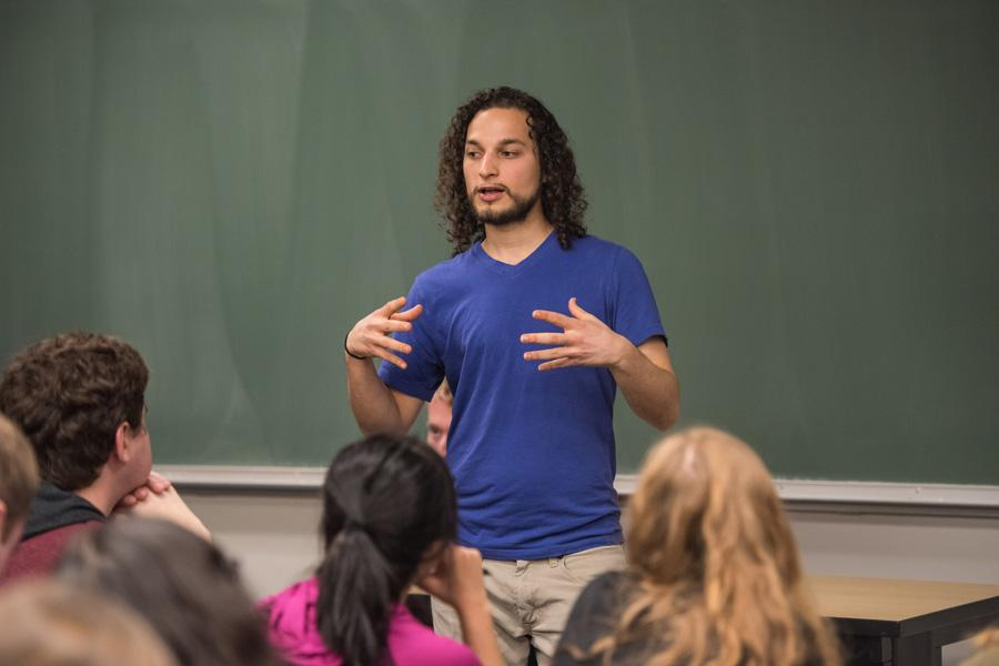 Student Action NU co-founder Scott Brown speaks at the group's meeting on Tuesday night. During the meeting, students expressed support for the Student Access Bill by calling state representatives and leaving voicemails encouraging them to vote in favor of the bill.