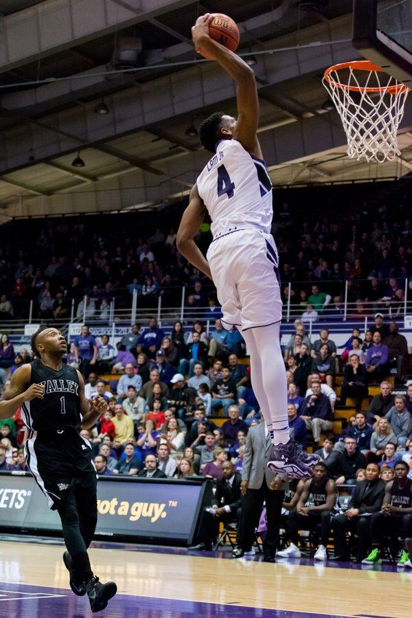 Vic+Law+rises+up+to+finish+a+dunk.+The+sophomore+should+help+invigorate+the+Wildcats%E2%80%99+offense+this+year+after+he+redshirted+last+season.+