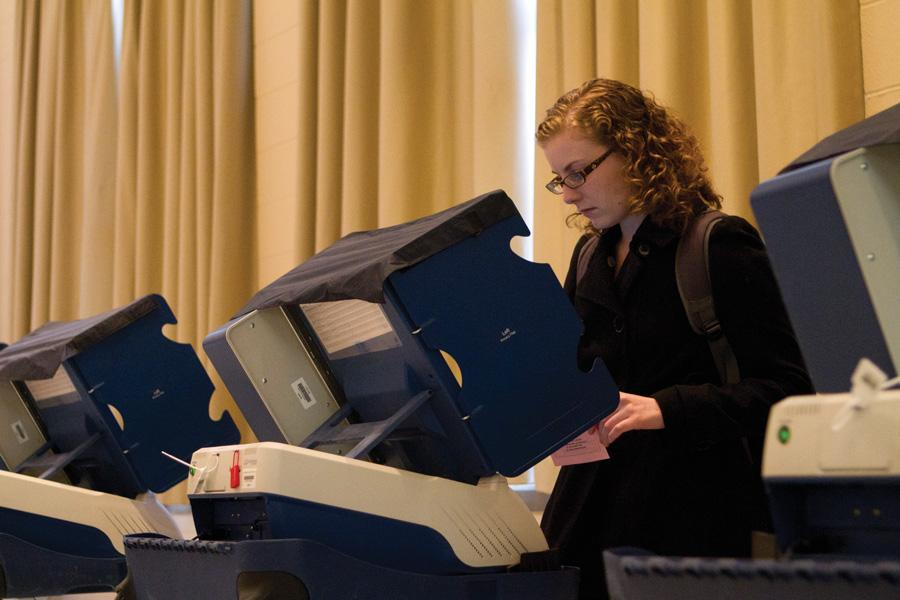 A student votes in the 2012 elections. Early voting is at a record high in Evanston and suburban Cook County.