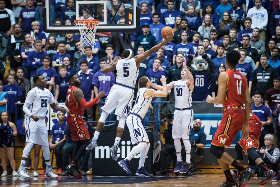 Dererk Pardon reaches out to grab a rebound. The sophomore center now has a key role as Northwestern's starter in the middle.