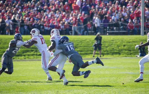 Godwin Igwebuike dives for a tackle. The junior safety leads the Wildcats in tackles with 95.