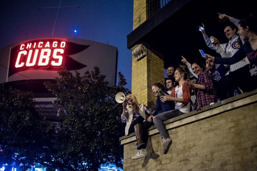 Cubs fans cheer in Wrigleyville following the team's World Series win on Wednesday night. The Cubs defeated the Cleveland Indians in a 10-inning Game 7, ending a 108-year championship drought.