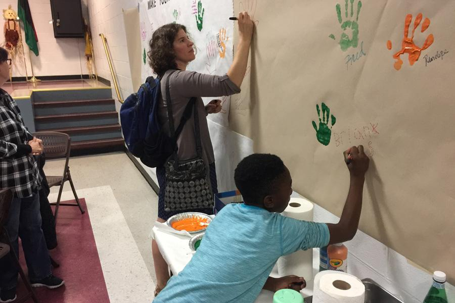 A woman and a child attend the diversity workshop held by Enrich Evanston in October. Enrich Evanston aims to increase diversity and inclusion efforts within the Evanston arts.