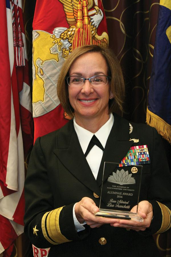 Rear Adm. Lisa Franchetti (Medill '85) holds her Alumnae Award, which she received in October. Franchetti is one of fewer than 40 women to become an admiral in the U.S. Navy.