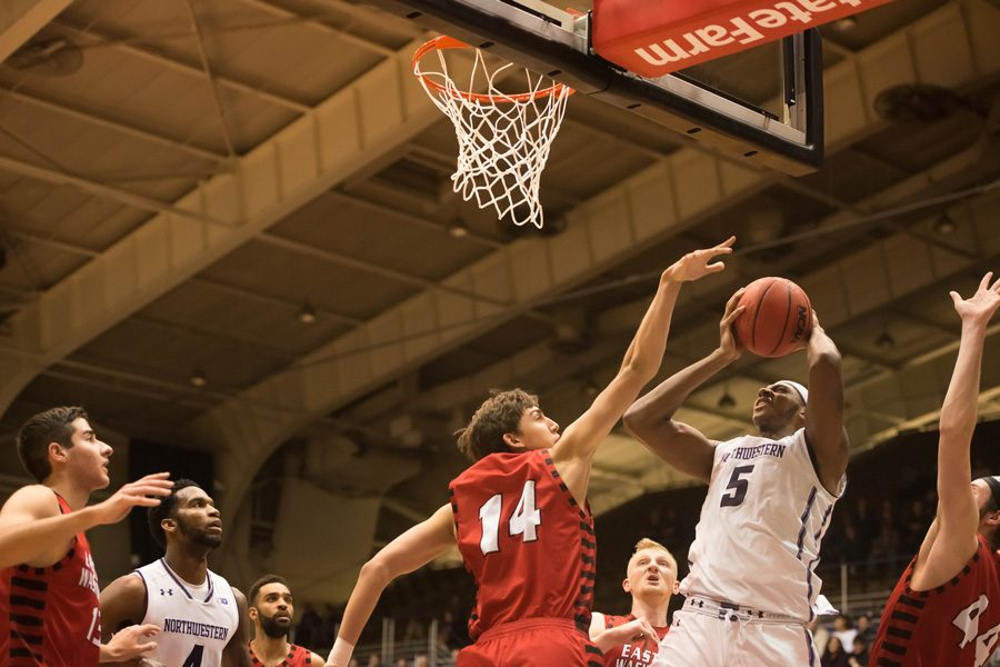 Dererk Pardon battles up a shot inside. The sophomore center fouled out late in Northwestern's 70-68 loss at Butler on Wednesday.