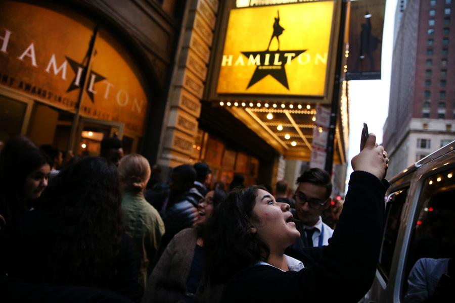 Diana Andrade, 17, takes a photograph outside the PrivateBank Theatre where Hamilton is making its Chicago premiere on Wednesday, Oct. 19, 2016 in Chicago. Andrade was among a group of students from Chicago Hope Academy who were attending the premiere. Northwestern will offer two courses on Hamilton during Winter Quarter.