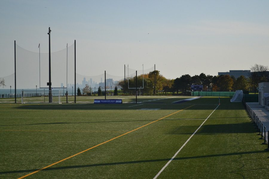 "The Chicago skyline rises beyond Hutcheson Field, a new outdoor practice field constructed this year. Northwestern has invested significantly in lakeside athletic facilities since the start of the $3.75 billion ""We Will"" campaign."
