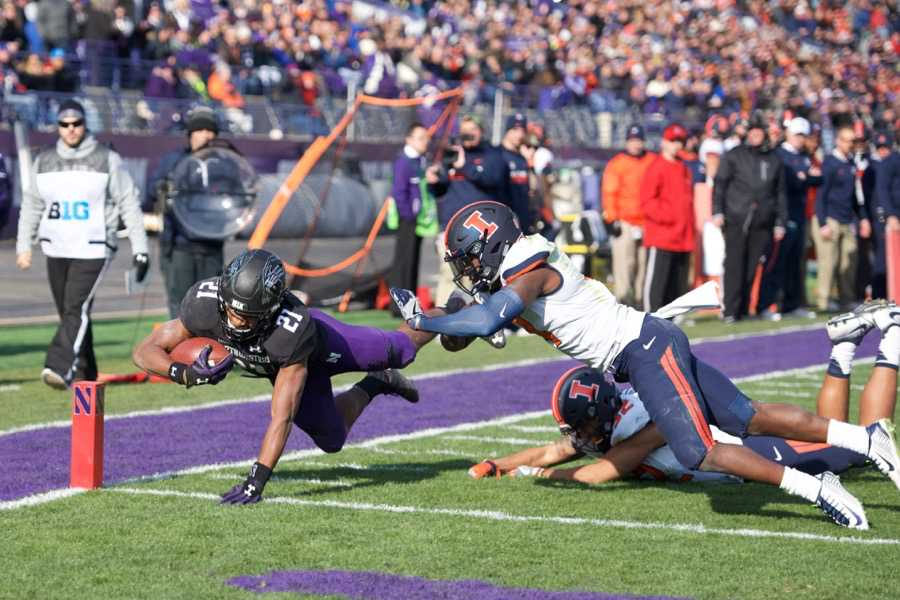 Justin Jackson dives into the end zone. The junior running back rushed for 173 yards and three touchdowns against Illinois.