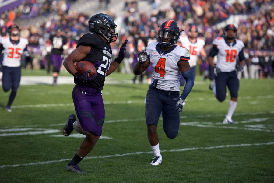 Justin Jackson carries the ball. The junior ran for 173 yards and three touchdowns against Illinois.