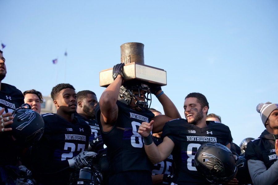 Northwestern players celebrate their victory over Illinois. It is the second straight year the program has captured the Land of Lincoln trophy.