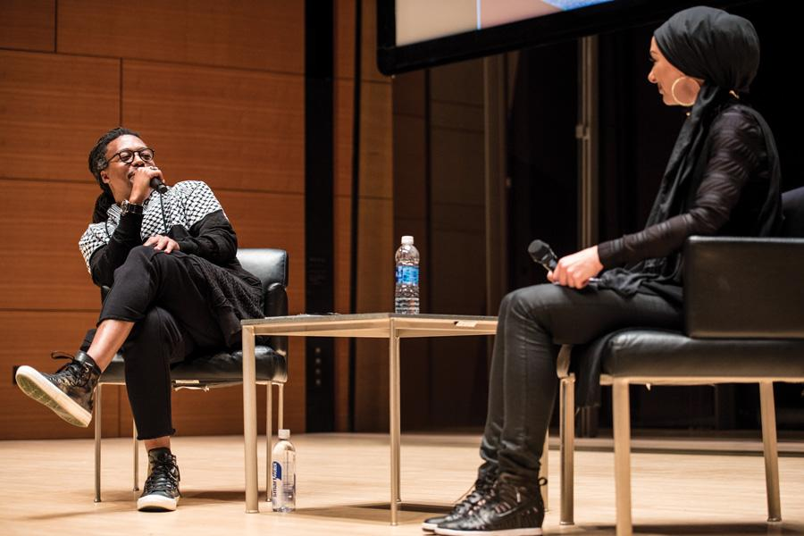 Chicago-born rapper Lupe Fiasco speaks during McSA fall speaker event Thursday night. Fiasco discussed his personal experiences with the Muslim faith.