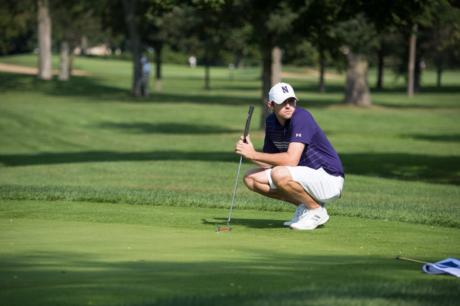 Conor Richardson bends down to read a putt. The graduate student drained a putt at the end of a match Wednesday to give Northwestern a tie for third at the Gifford Collegiate.