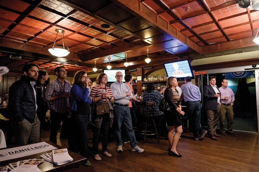 Evanston residents gather at Tommy Nevin's Pub to watch the first presidential debate. The viewing party was hosted by Democratic Reps. Laura Fine and Robyn Gabel and state Sen. Daniel Biss.