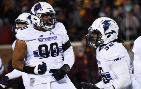 Football: Northwestern bids farewell to defensive bookends C.J. Robbins, Ifeadi Odenigbo