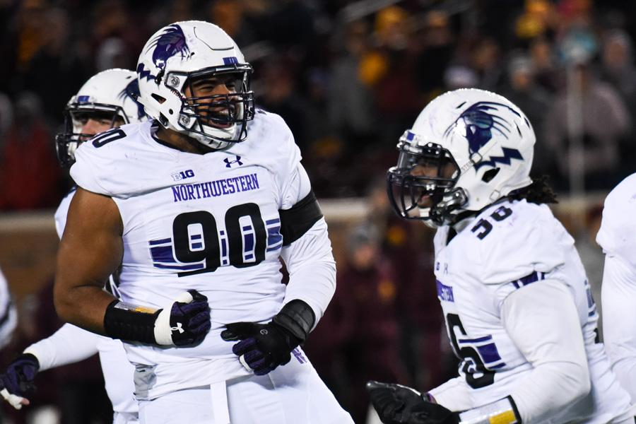 C.J. Robbins celebrates a play. The senior defensive end, along with fellow DL Ifeadi Odenigbo, will play their final games at Ryan Field this Saturday when the Wildcats host Illinois.