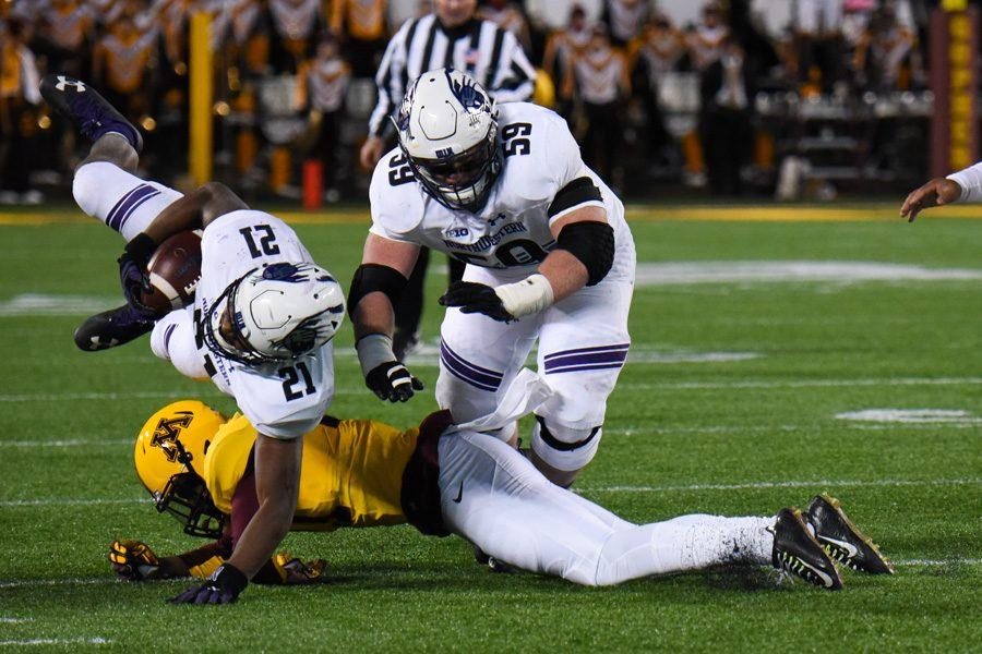Justin+Jackson+tries+to+keep+his+balance.+The+junior+running+back+and+the+Wildcats+failed+to+take+advantage+of+several+opportunities+in+Saturday%E2%80%99s+loss+to+Minnesota.