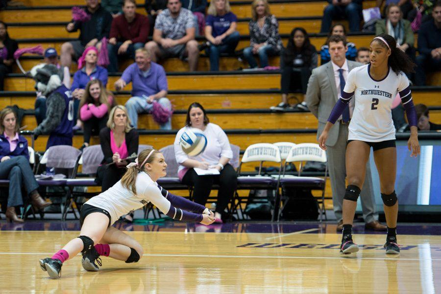 Kaitlin Tavarez reaches for a dig. The senior defensive specialist and Northwestern passed better in Saturday's match against Michigan than in Friday's matchup with Michigan State, but failed to win either game in a weekend sweep.