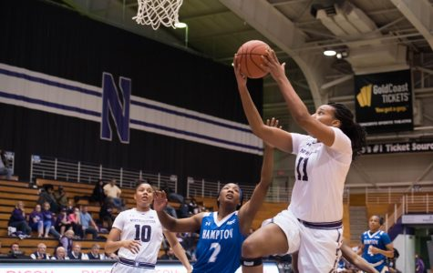 Lauren Douglas goes up for a layup. The senior forward led NU with 18 points in a loss to crosstown rival DePaul.