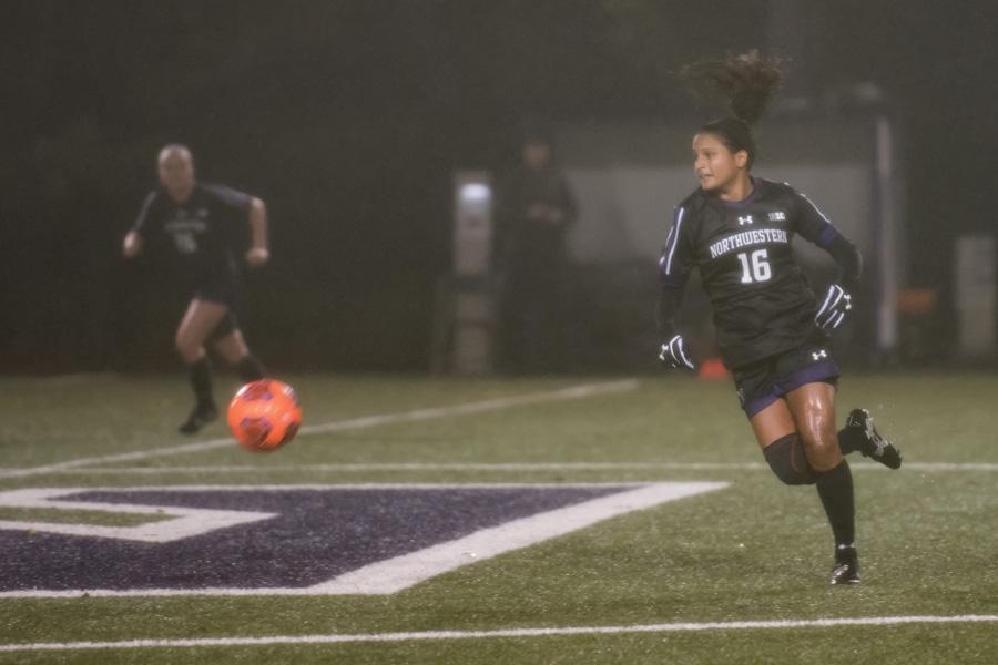 Nandi Mehta turns in the midfield. The graduate midfielder and Northwestern will look to begin its NCAA Tournament run with a win Saturday against Kent State.