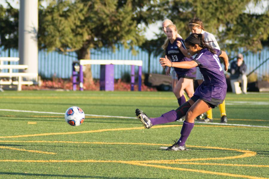 Nandi Mehta takes a penalty kick. The graduate midfielder scored Northwestern's second goal in a 3-0 victory over Kent State in the first round of the NCAA Tournament.