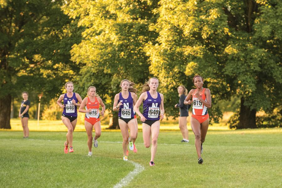 Sarah Nicholson (left-center) and Aubrey Roberts (right-center) round a turn. The two freshmen again led the way for Northwestern at the Big Ten Championships, where the team finished ninth overall.