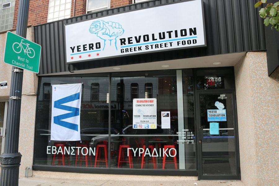 """Yeero Revolution """"flies the W"""" outside their restaurant, 1009 Davis St., on Tuesday. The fast-casual Greek restaurant is set to open next week."""