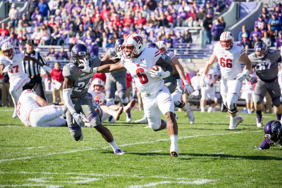 Wisconsin running back Corey Clement stiff arms sophomore cornerback Montre Hartage. Clement tallied 106 yards on the ground Saturday.