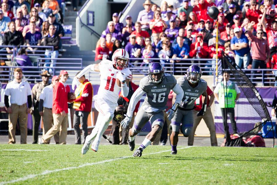 Wisconsin receiver Jazz Peavy evades tacklers on his 46-yard end-around score. The Wildcats had no answer for the Badgers' running game, as Wisconsin tallied 190 rushing yards Saturday.