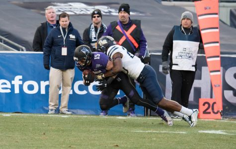 Macan Wilson catches a pass in the Pinstripe Bowl. With Austin Carr graduating, Wilson figures to be a big part of Northwestern's 2017 plans.