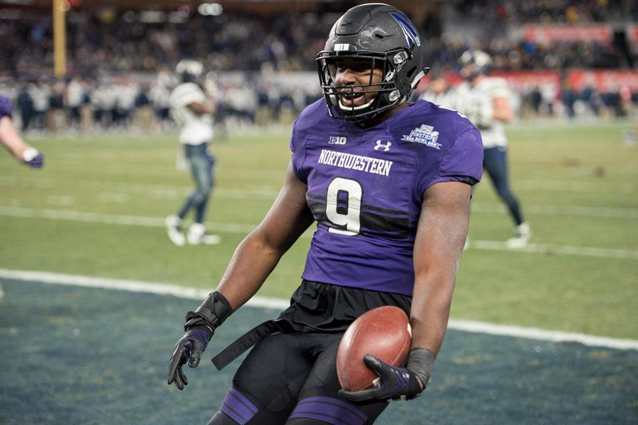 Garrett Dickerson celebrates after scoring Northwestern's go-ahead touchdown in the Pinstripe Bowl. The junior's reception came on fourth down.