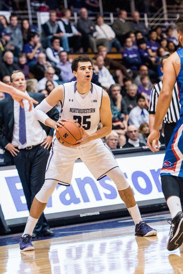 Aaron+Falzon+looks+to+pass.+The+sophomore+forward+will+miss+the+remainder+of+the+season+after+undergoing+knee+surgery.