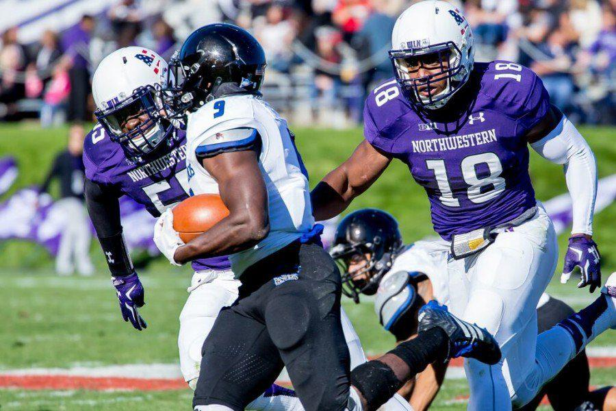 Anthony Walker (18) chases a ball-carrier during Northwesterns win over Eastern Illinois. The sophomore linebacker recorded seven tackles in the game, bringing his season total to a team-leading 17.