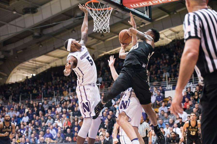 Dererk+Pardon+challenges+a+shot+inside.+The+sophomore+center+injured+his+hand+in+the+Wildcats%27+win+over+Wake+Forest.