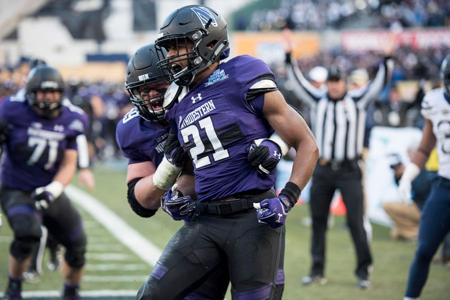 Justin Jackson celebrates a touchdown. The junior running back found the end zone three times against No. 23 Pittsburgh.
