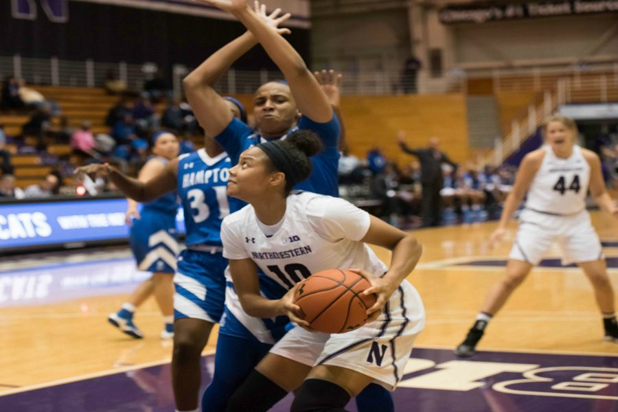 Nia Coffey looks toward the hoop. The senior forward led the Cats with 19 points and went a perfect 10-for-10 at the free throw line Tuesday.
