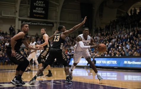 Scottie Lindsey drives to the hoop. The junior guard led NU with 19 points.