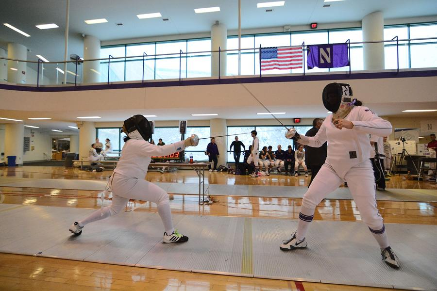 Katie Van Riper fences against an opponent. The junior went 9-3 in the Cats' big weekend.